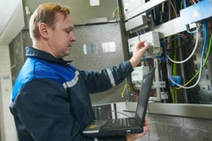 Electrician working on commercial electrical panel